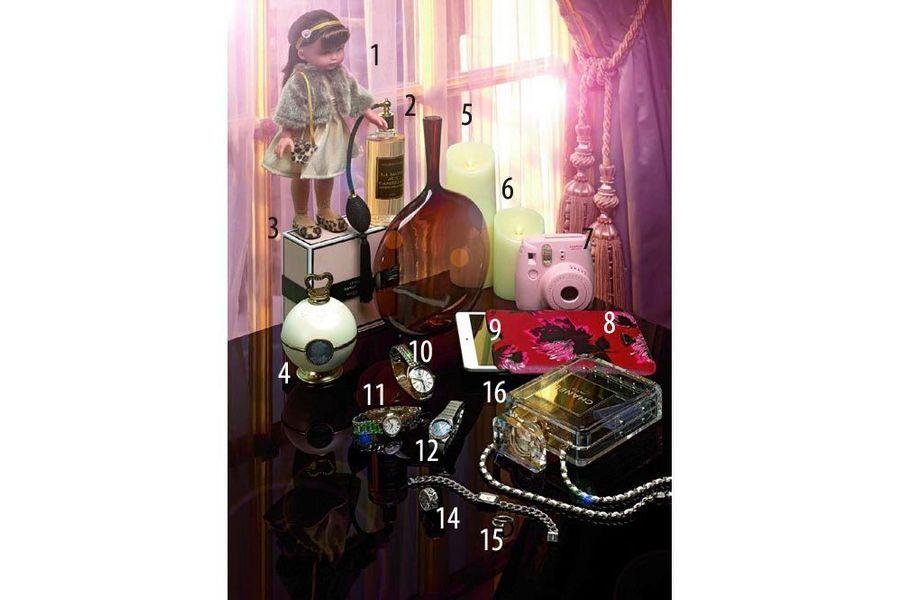 1. Poupée, édition limitée Les Chéries « Chloé au Palais Royal », Corolle, 50 €. 2. Parfum « La Dame aux Camélias », cologne de nuit, 250 ml, Jardins d'Ecrivains, The Conran Shop, 115 €. 3. Cof ret « Dahlia Noir Le Bal », eau de parfum 75 ml, Givenchy, 113,50 €. 4. Poudre libre visage, Ladurée, en exclusivité chez Sephora, 45 € le pot vide, 82 € la recharge. 5. Vase « Angelic », fait main, en verre souf é, design Joe Cariati, The Conran Shop, 245 €. 6. Bougies à LED en cire véritable, Smart Candle, à partir de 35,50 €. 7. Appareil photo Instax mini 8, Fujifi lm, 79,90 €. 8. Etui pour iPad mini en cuir, Prada en exclusivité pour le Printemps, 200 €. 9. iPad mini à écran 7,9 pouces, Apple, à partir de 299 €. 10. Montre « Liens » en acier, mouvement automatique, Chaumet, 3 900 €. 11. Montre « Prima Luna » en acier, mouvement quartz et lunette sertie diamants, Longines, 2 000 €. 12. Montre Constellation « Orbis » automatique en acier, lunette sertie de diamants, Omega, 6 400 €. 13. Montre « Première » en acier et cadran en nacre, mouvement quartz, Chanel Horlogerie, 3 350 €. 14. Bague My Dior en or blanc et diamants, Dior Joaillerie, à partir de 2 000 € sans diamants. 15. Bague « Juste un Clou » en or blanc, Cartier, 1 970 €. 16. Minaudière en Plexiglas, Chanel, 6 500 €.