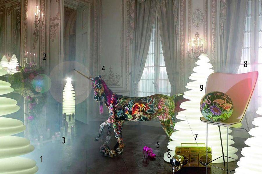 Fées contemporaines, lutins geeks, princes éternels, elfes rockeurs… Entrez dans la lumière de Noël et recevez nos présents de rêve.Par Aurélie des Robert et Louise Parisot1. Sapin « Chrism » design Teresa Sapey, de 25 cm à 200 cm, Vondom, de 60 € à 1 400 €. 2. Chandelier « Raw », design Jens Fager pour Muuto, en bois peint, Silvera, 99 € et bougies, Point à la ligne. 3. Bougies à LED en cire véritable, à partir de 35,50 €, Smart Candle. 4. Licorne avec corne d'oryx, et collier géant, en mousse polyuréthanne habillés de tapisserie vintage, Frédérique Morrel, prix sur demande. 5. Sandales en cuir métallisé, Walter Steiger, 790 €. 6. Enceinte « AeroSkull », Jarre Technologies, 399 €. 7. Ghettoblaster i931 BT Gold Limited, fonction Bluetooth, compatible utilisation carte SD et clé USB, Lasonic au Printemps, 300 €. 8. Chaise haute « Marthe », en laiton vieilli habillé de tissu Dominique Kief er, H 1,65 m, design Stéphanie Langard, Starter Gallery, prix sur demande. 9. Boule en mousse habillée de tapisserie vintage, Frédérique Morrel, prix sur demande. Fleurs, Interflora.Assistants : Linda Berard (mode), Sophie Ju (déco) et Valentin Chemineau (photo).Photos réalisées dans les salons historiques de l'hôtel Shangri-La, Paris.