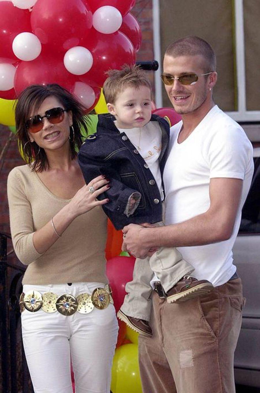 En 2001 avec leur premier fils Brooklyn
