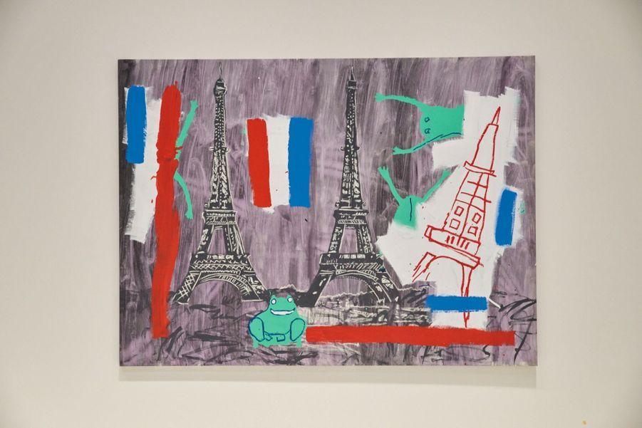 Collaboration avec Andy Warhol pour cette toile de 1985 intitulée « Eiffel Tower ». Les grenouilles, la tour de droite et les drapeaux sont de Basquiat.