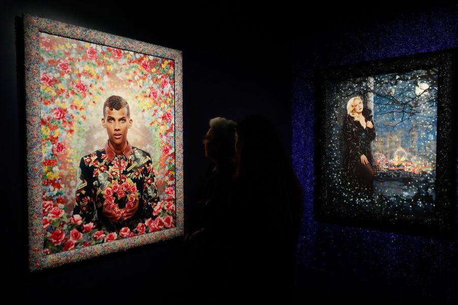 """Inauguration de l'exposition de Pierre et Gilles, """"La Fabrique des idoles"""" à la Philharmonie à Paris. Ici deux oeuvres avec Stromae et Sylvie Vartan."""