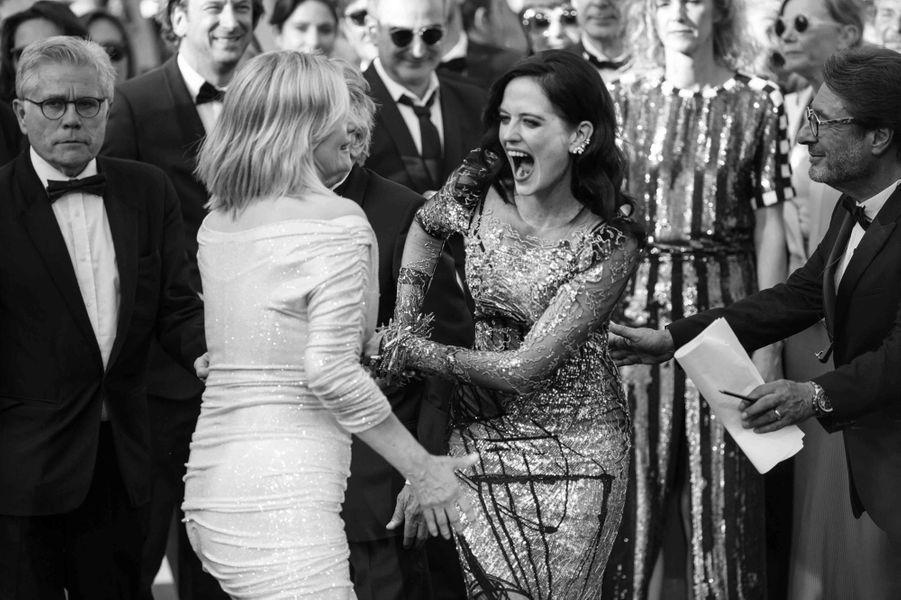 Roman Polanski, son épouse Emmanuelle Seigner et Eva Green ambiancent le tapis rouge.