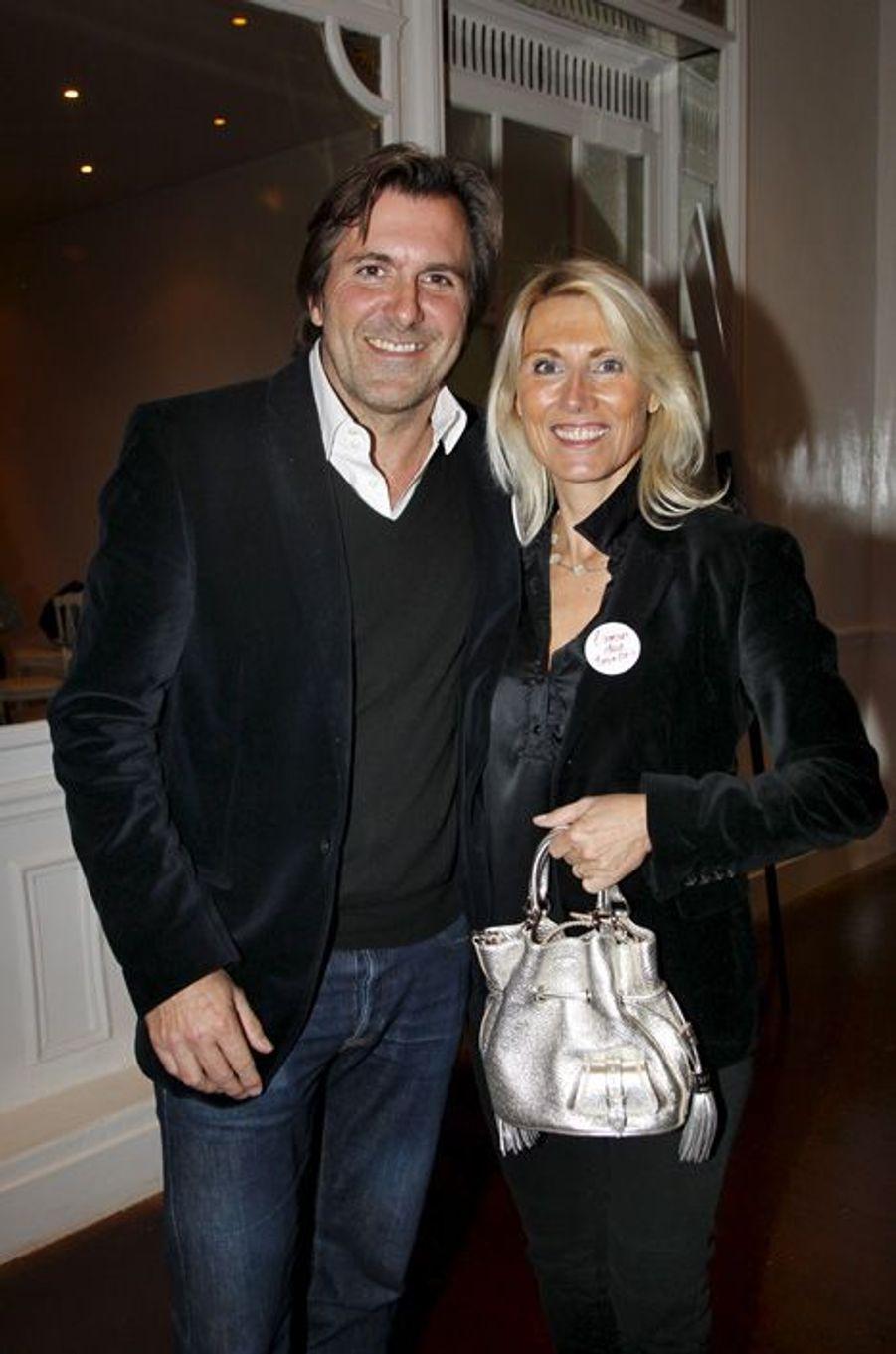 """Christophe Lambert et Marie Sara à la première de """"L'amour dure trois ans"""", en janvier 2012."""