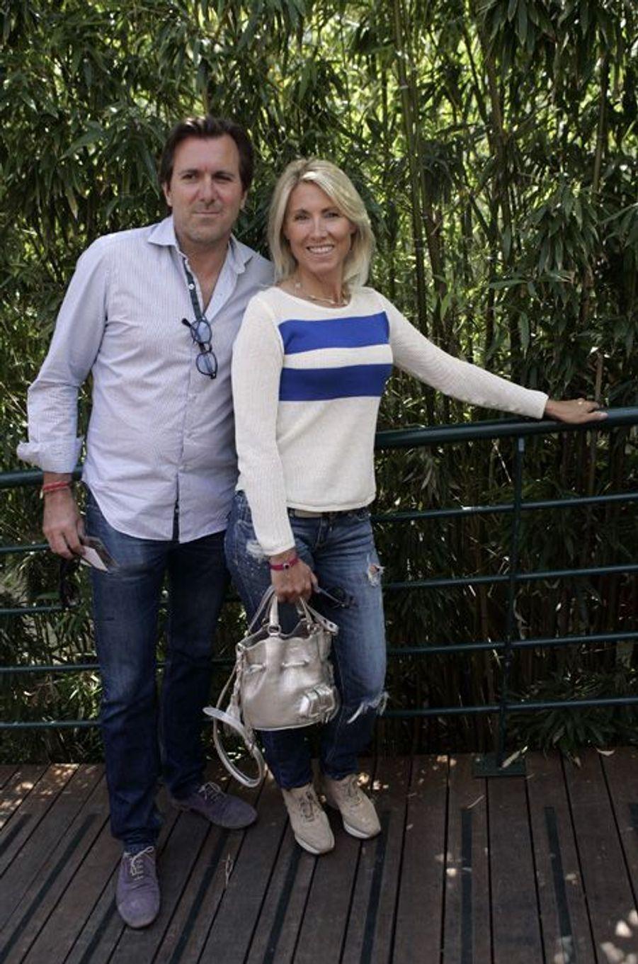 Christophe Lambert et Marie Sara à Roland-Garros, en juin 2012.