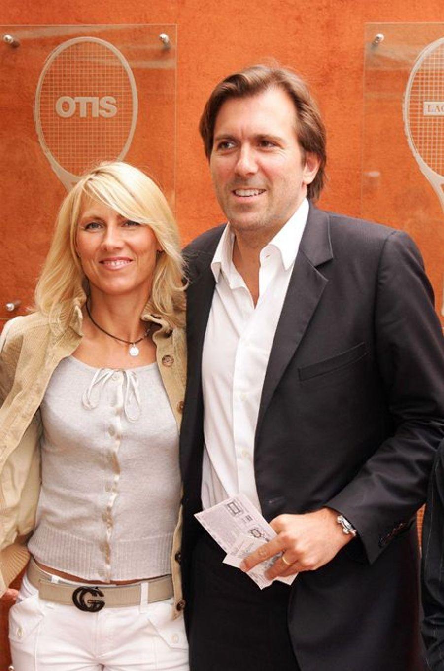 Marie Sara et Christophe Lambert à Roland-Garros, en juin 2005.