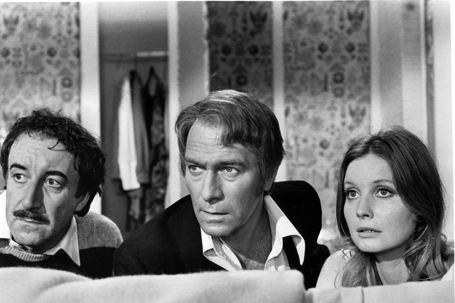 """Peter Sellers, Christopher Plummer et Catherine Schell dans """"Le Retour de la panthère rose"""" en 1975."""