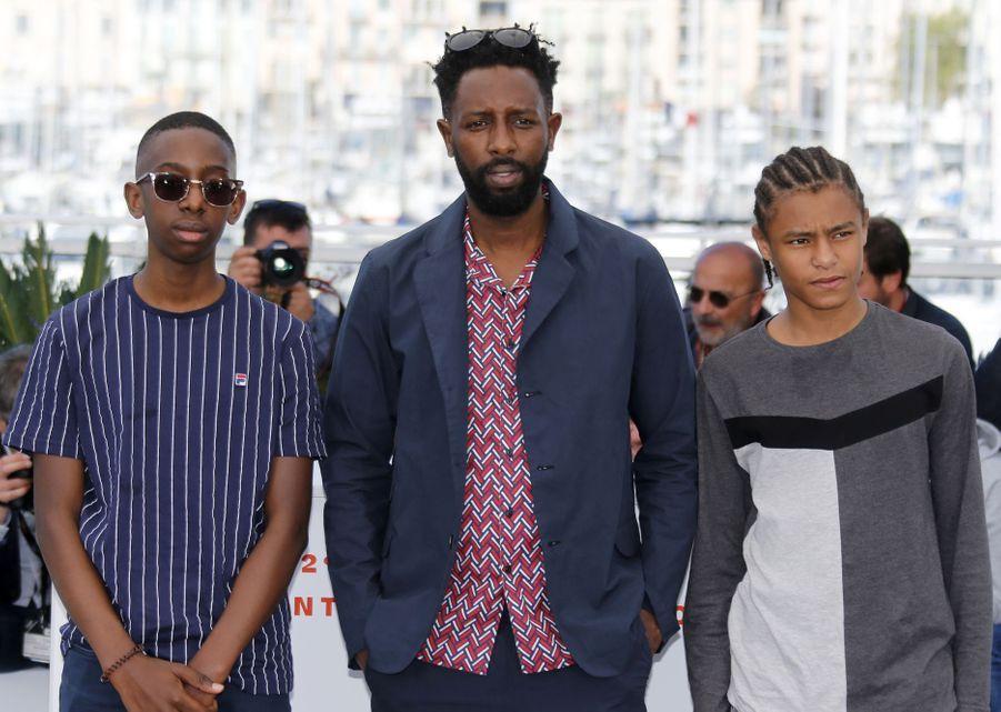 Ladj Ly, Al Hassan Ly et Issa Pericalors du photocall du film «Les Misérables» le 16 mai 2019