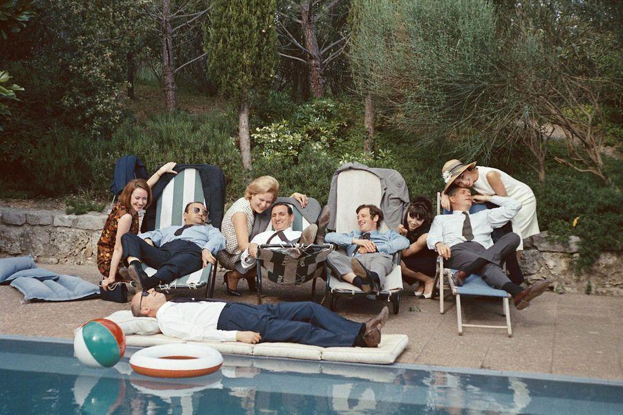 Henri Verneuil, Lino Ventura, Jean-Paul Belmondo, Reginald Kernan, Michel Audiard et leurs compagnes présentent « Cent mille dollars au soleil »Festival de Cannes 1964