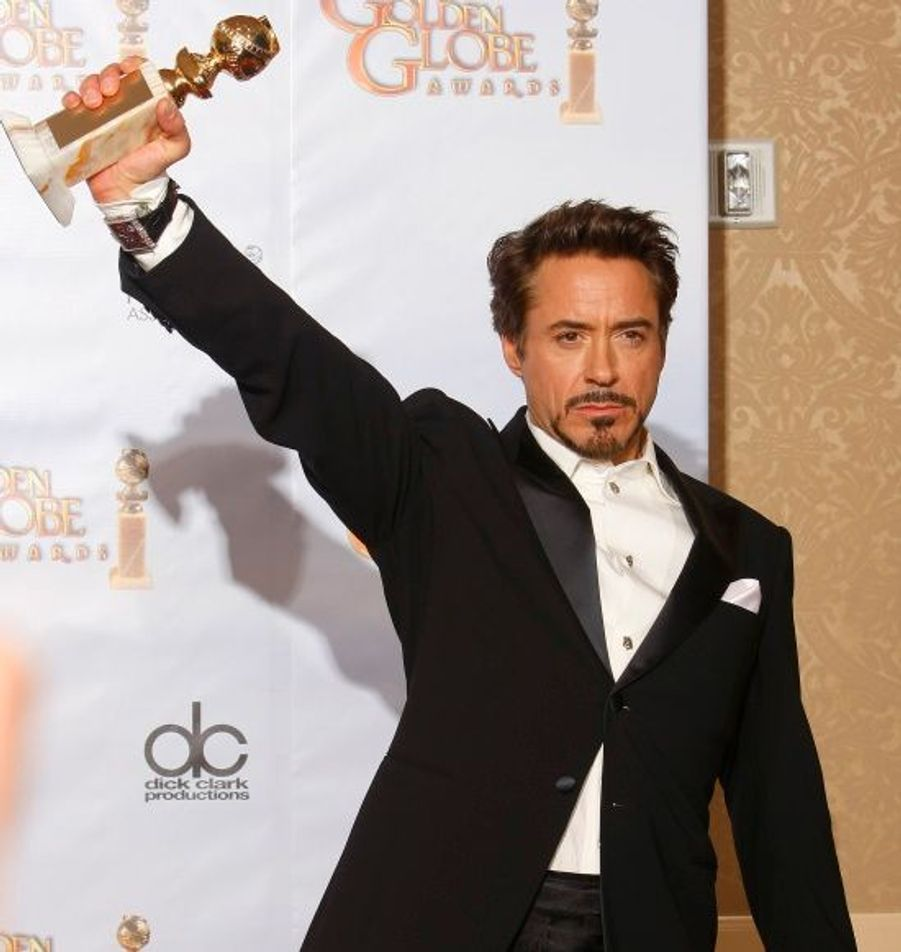 Meilleur acteur dans un film musical ou comédie pour Sherlock Holmes.