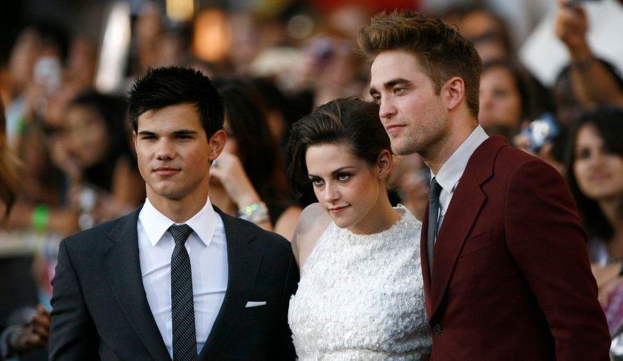 Taylor Lautner, Kristen Stewart et Robert Pattison se sont prêtés au jeu de la traditionnelle séance photo.