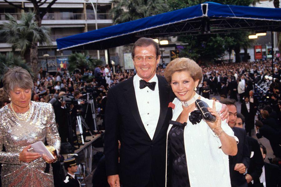 Roger Moore et son épouse Luisa Mattioli, au Festival de Cannes 1991.