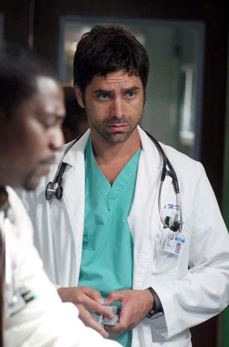 Dr. Tony Gates (John Stamos)