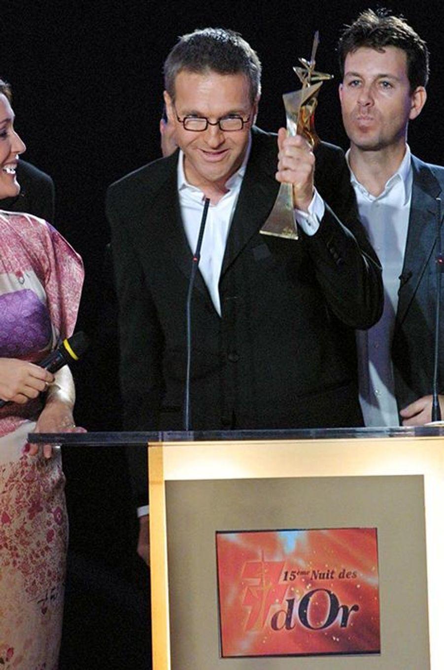 """Avec le 7 d'Or de la meilleure Èmission d'humour pour """"On a tout essayé"""" en 2001"""