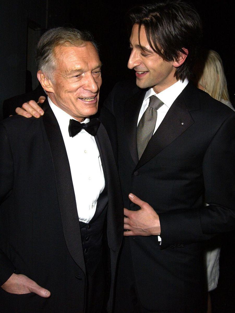 Hugh Hefner et Adrian Brody aux 60ème Golden Globes.