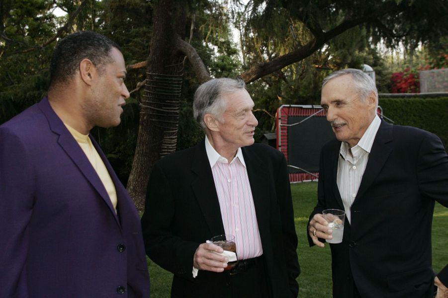 Laurence Fishburne, Hugh Hefner et Dennis Hopper lors d'un cocktail organisé au Manoir Playboy.