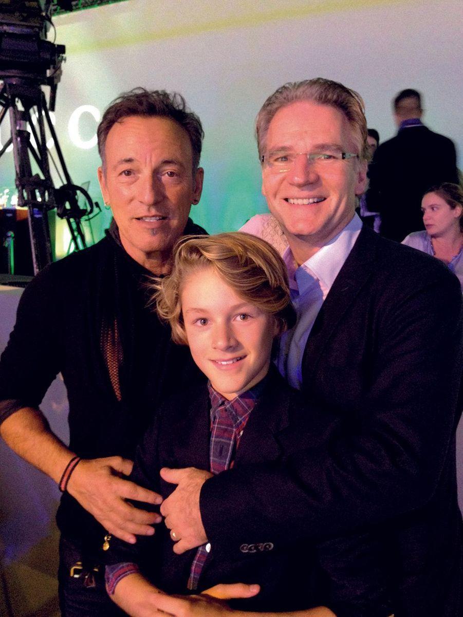 Avec Bruce Springsteen et son fils Benjamin, 11 ans, aux Gucci Masters en 2013.