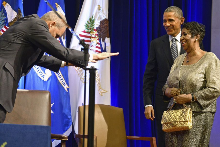 Eric Holder, Barack Obama et Aretha Franklin, en février 2015.