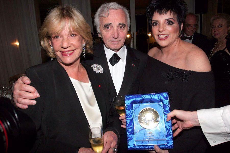 Jeanne Moreau, Charles Aznavour et Liza Minelli, en mai 2005.