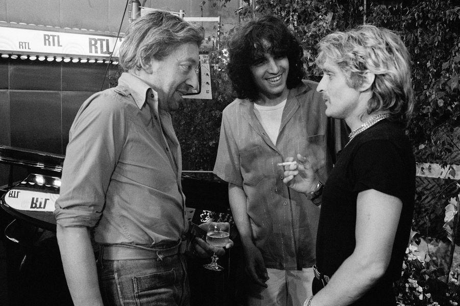 Serge Gainsbourg, Julien Clerc et Christophe lors d'une émission sur RTL, en juin 1978.