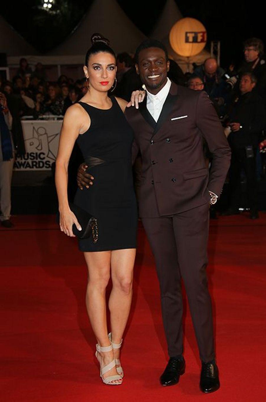 Corneille et sa compagne à Cannes le 13 décembre 2014