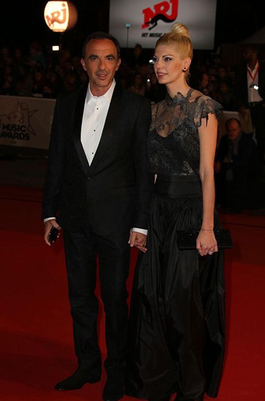 Nikos Aliagas et son épouse, Tina, à Cannes le 13 décembre 2014