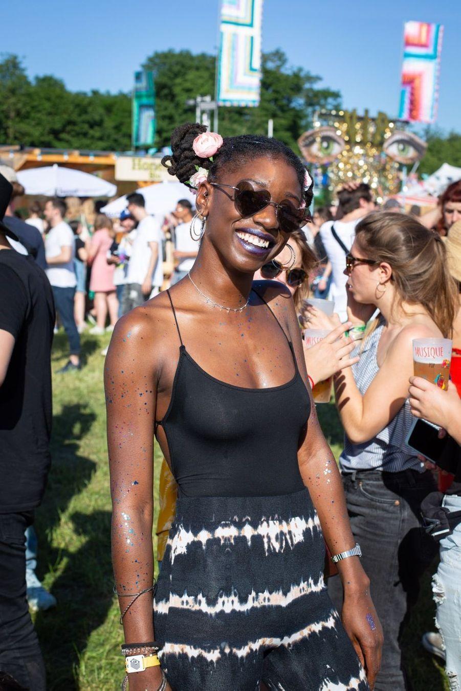 Marie, 27 ans vit à Saint-Denis et travaille chez Apple. C'est la deuxième fois qu'elle vient au Festival et cette année c'est pour écouter Erykah Badu.