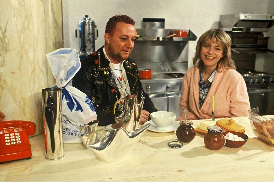 Avec Coluche lors d'une émission de TF1 en 1984.