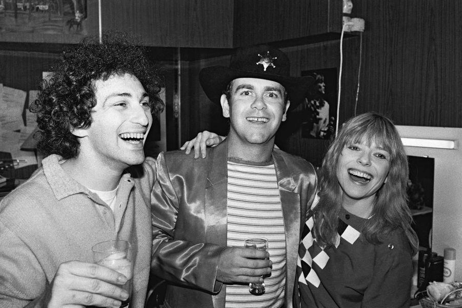 Avec Michel Berger et Elton John dans les coulisses du Palais des Sports en 1981.