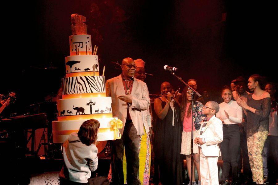 Pour célébrer ses soixante ans de carrière, Manu Dibango a réuni « quelques » amis au Palace, à Paris, le 12 décembre 2018. Des artistes venus des quatre coins de l'Afrique lui ont rendu hommage