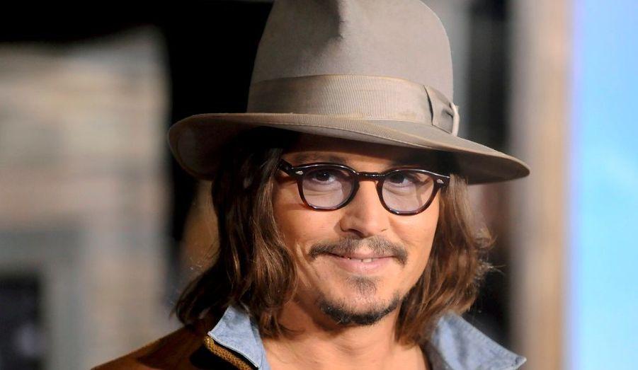 """Johnny Depp, qui prête sa voix à """"Rango"""", à l'avant-première du film d'animation réalisé par Gore Verbinski, à Los Angeles."""
