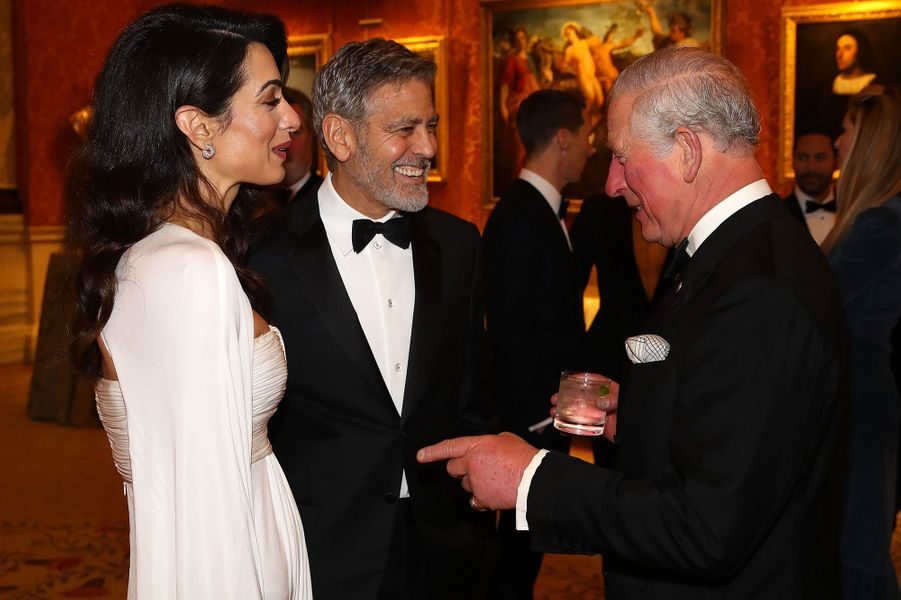 GeorgeetAmal Clooney avec le prince Charles au palais deBuckingham