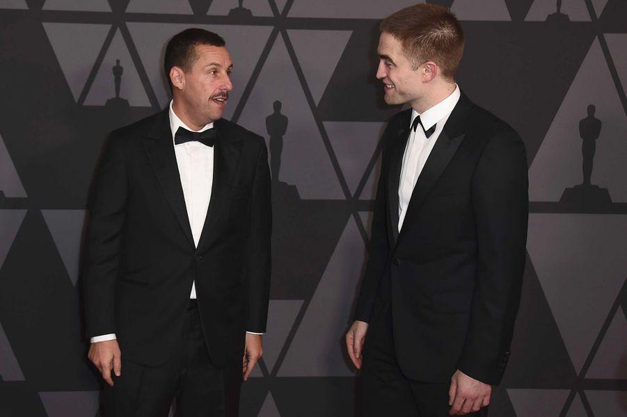 Adam Sandler et Robert Pattinson aux Governors Awards à Los Angeles, samedi 11 novembre