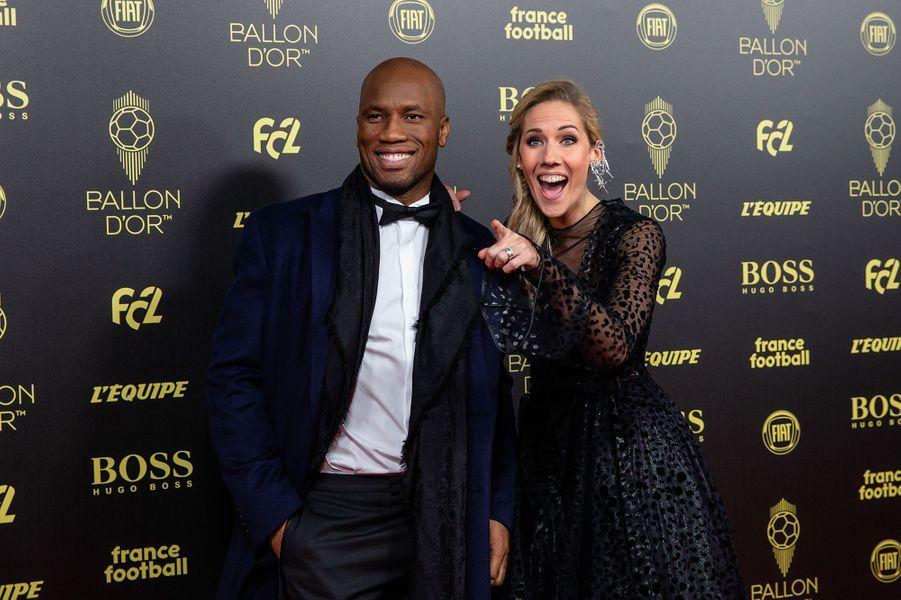 Didier Drogba et Sandy Heribert (présentateurs)à la cérémonie du Ballon d'Or 2019 à Paris le 2 décembre 2019