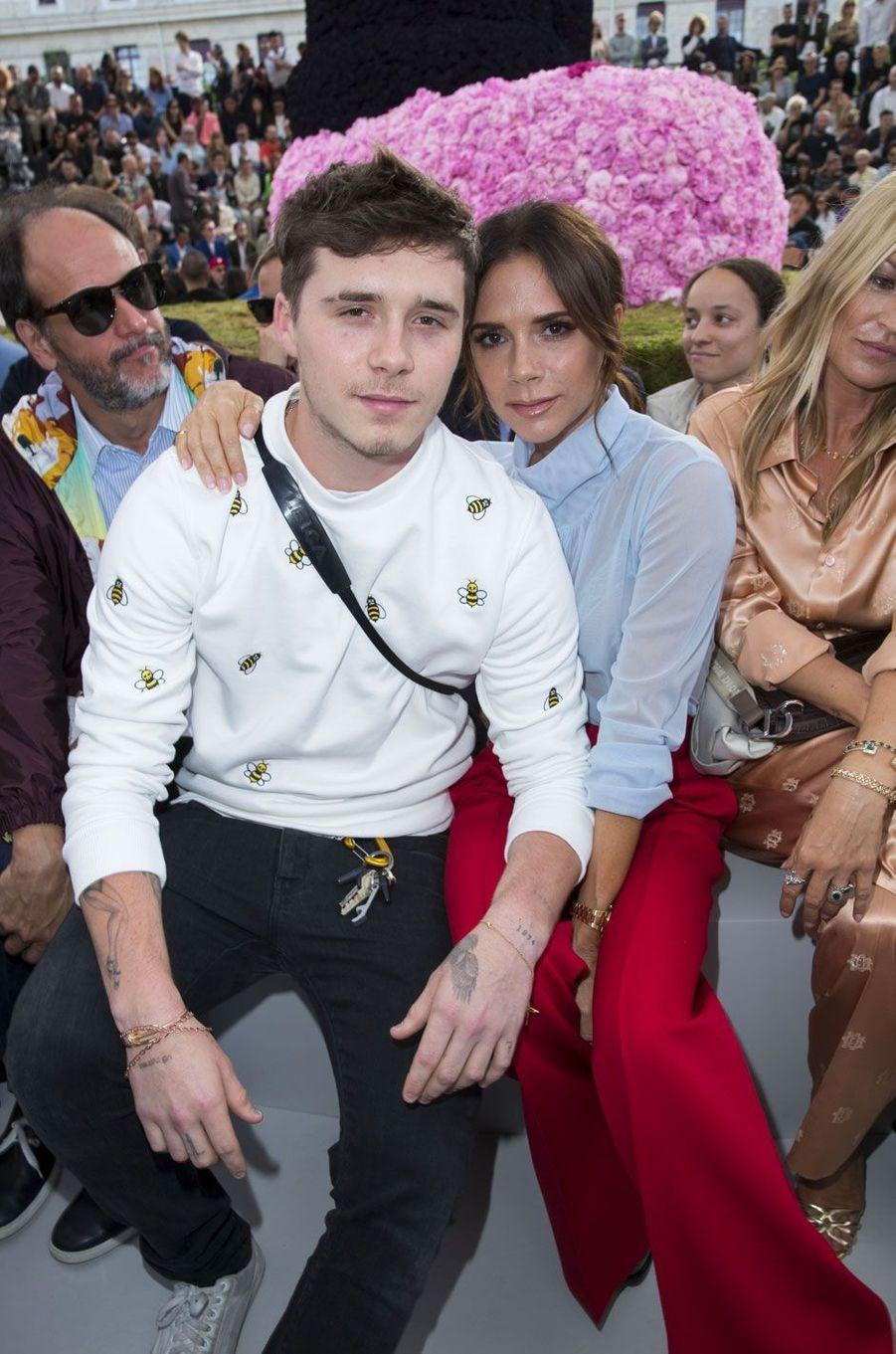 Victoria et Brooklyn Beckham au défilé Dior Homme, à Paris le 23 juin 2018