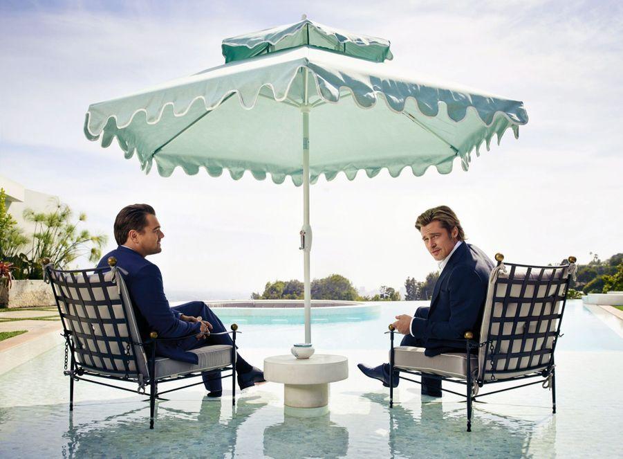 Leonardo DiCaprio et Brad Pitt, dans un décor hollywoodien. Dans la vraie vie, DiCaprio vient de produire « La glace en feu », un documentaire manifeste désignant les coupables du réchauffement planétaire.