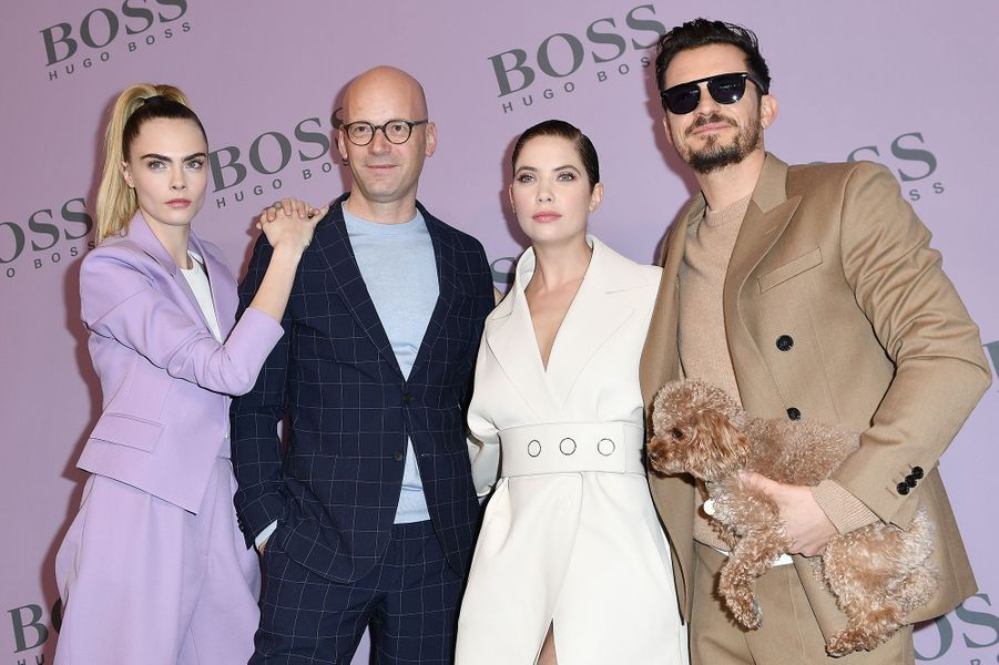 Cara Delevingne, Ashley Benson et Orlando Bloomau défilé Boss de la marque Hugo Boss pendant la Fashion Week de Milan le 23 février 2020.