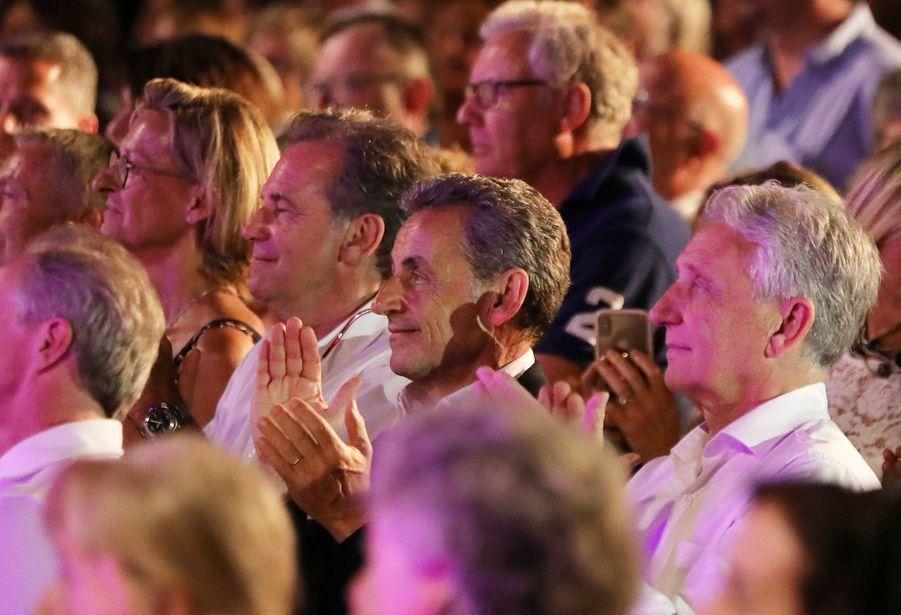 Nicolas Sarkozyau côté de Renaud Muselier etGil Bernardi au concert de Carla Bruni au Lavandou le 23 juillet 2019