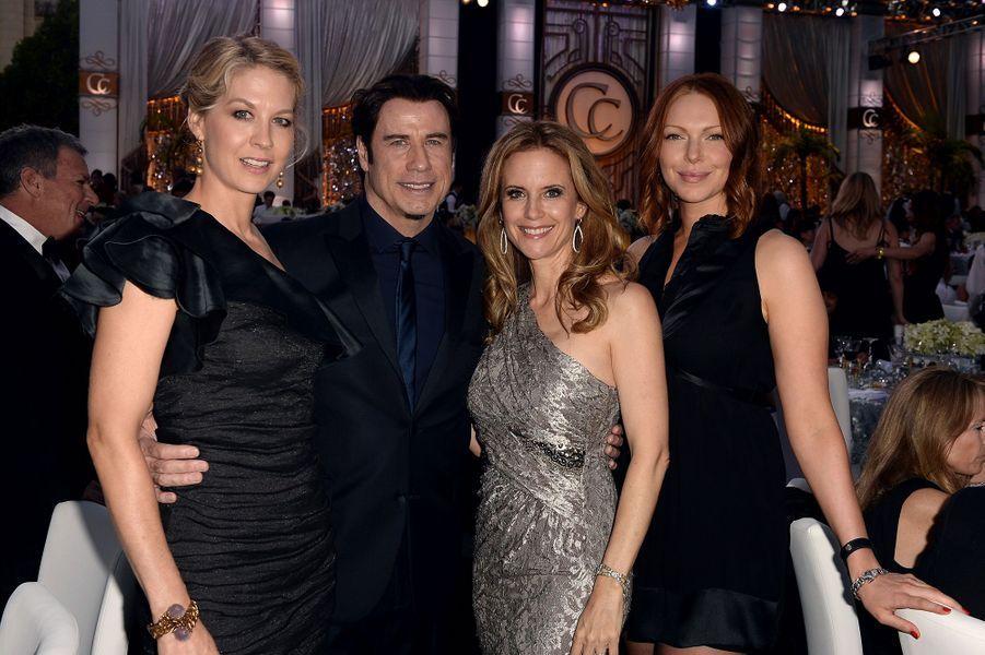 Jenna Elfman (depuis 1990), John Travolta (depuis 1975), Kelly Preston (depuis la fin des années 1980) et Laura Prepon (depuis 1999), quatre fervents membres. Ici lors d'une soirée organisée par l'Église de scientologie en 2013.