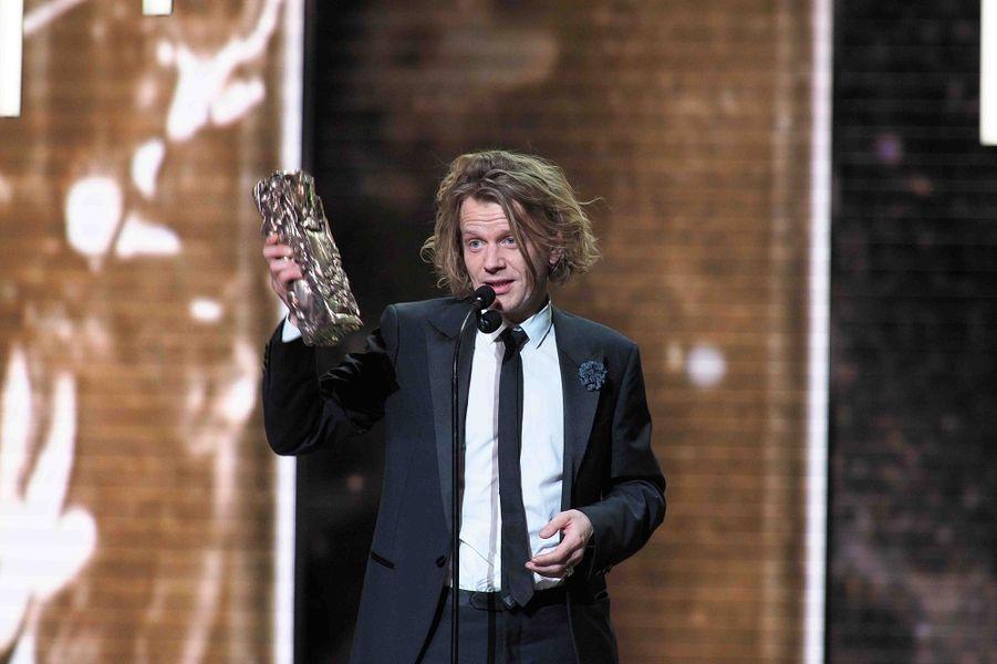 """Alex Lutz (meilleur acteur pour """"Guy"""")lors de la cérémonie des César à la Salle Pleyel à Paris le 22 février 2019"""