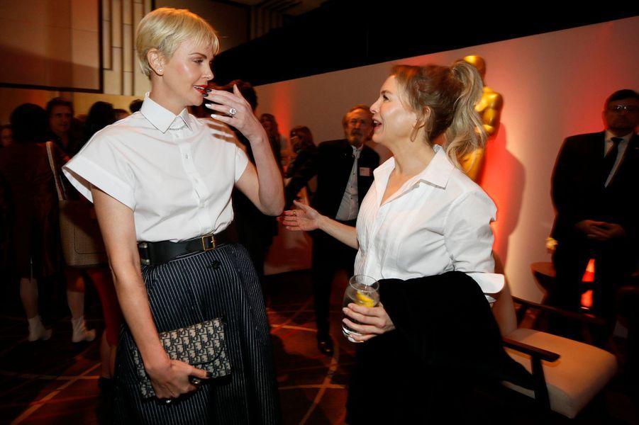 Renee Zellweger et Charlize Theronau déjeuner des nommés aux Oscars 2020 à Los Angeles, le lundi 27 janvier.