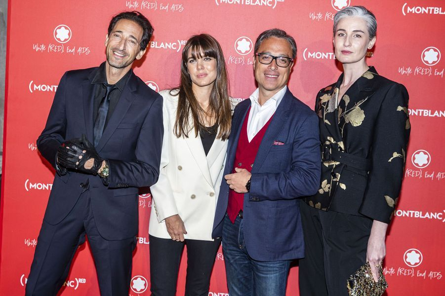 Adrien Brody, Charlotte Casiraghi, Nicolas Baretzki (PDG de Montblanc) et Erin O'Connor à la soirée Montblanc organisée pour le lancement de la collection «(Montblanc M)RED» au profit de l'association (RED) à Paris le 8 octobre 2019