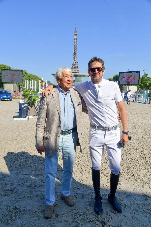 Guillaume Canet et son père Philippe lors du Longines Paris Eiffel Jumping au Champ de Mars à Paris le 7 juillet 2019