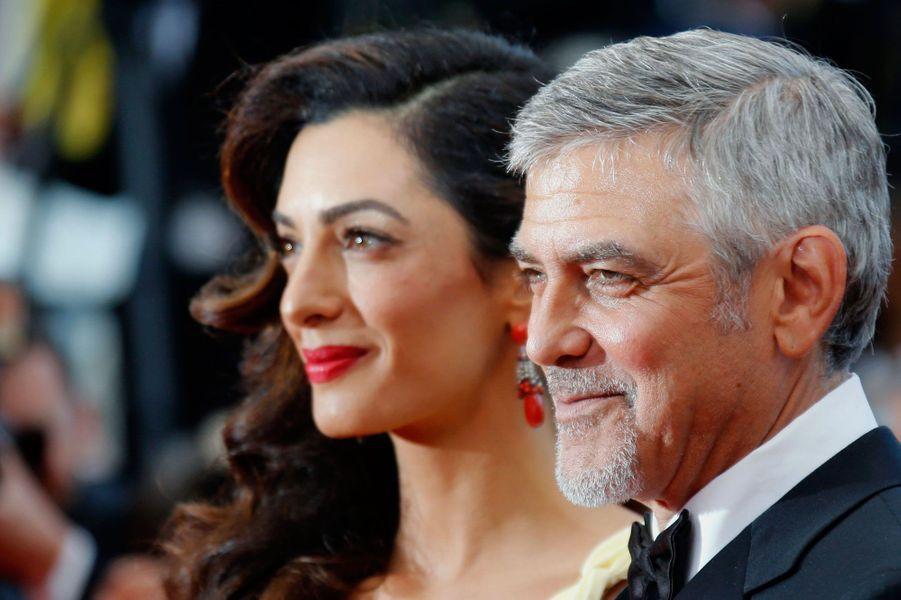 George Clooney et sa femme Amal sur le tapis rouge à Cannes