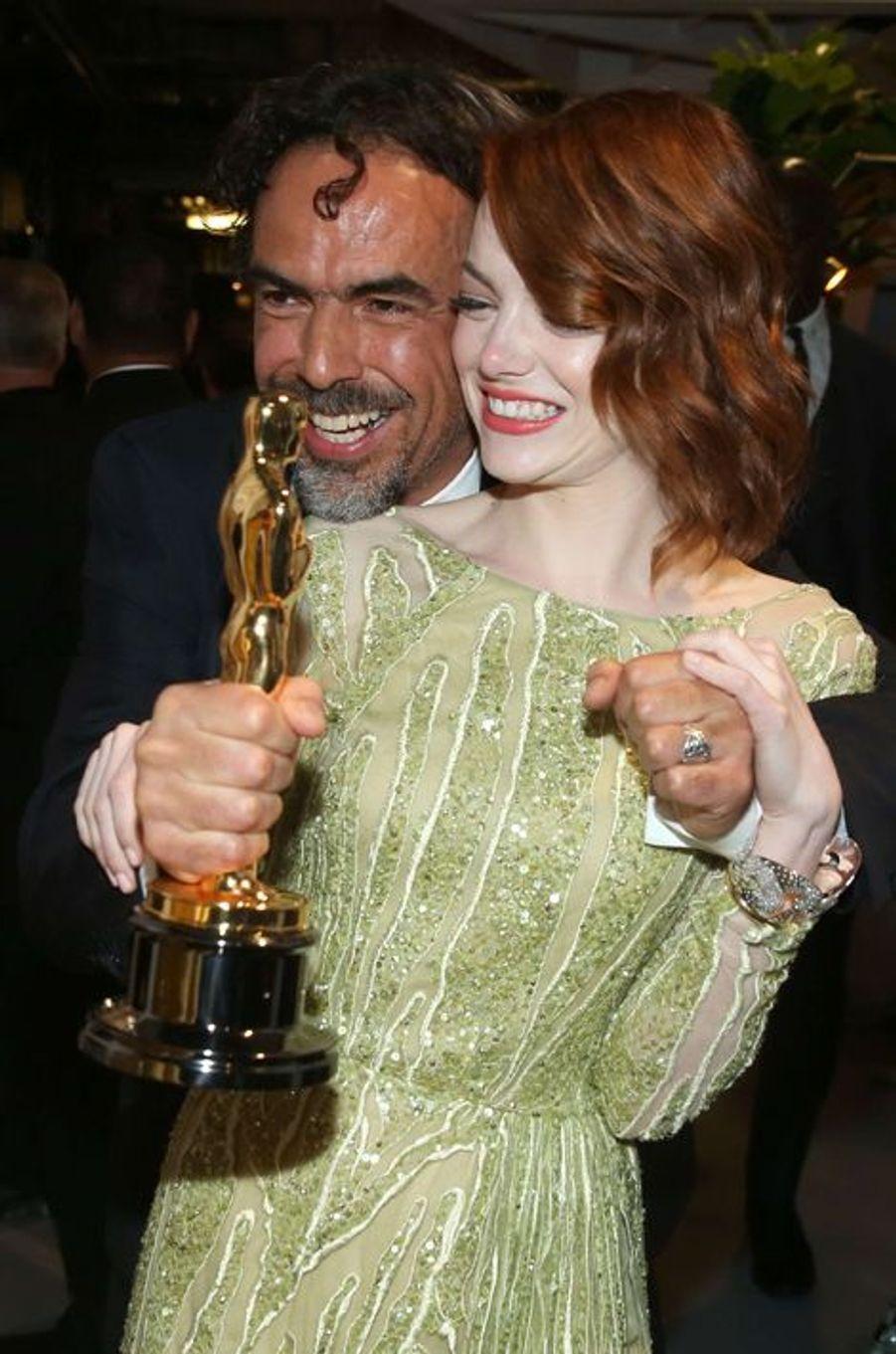 Alejandro González Iñárritu et Emma Stone dans les coulisses des Oscars, à Los Angeles le 22 février 2015