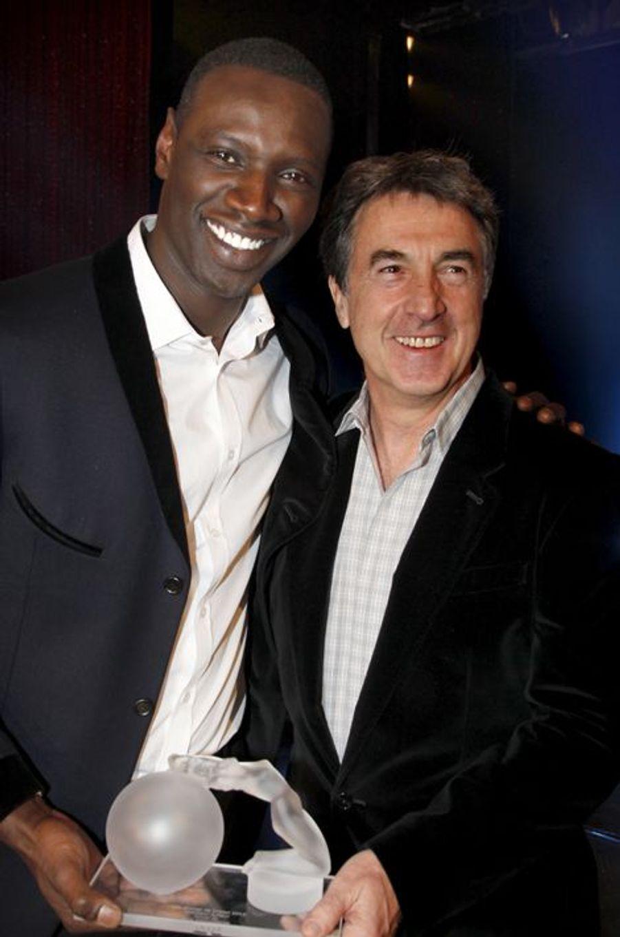 Avec Omar Sy en 2012 lors de la soirée de remise des Globes de Cristal au Lido.