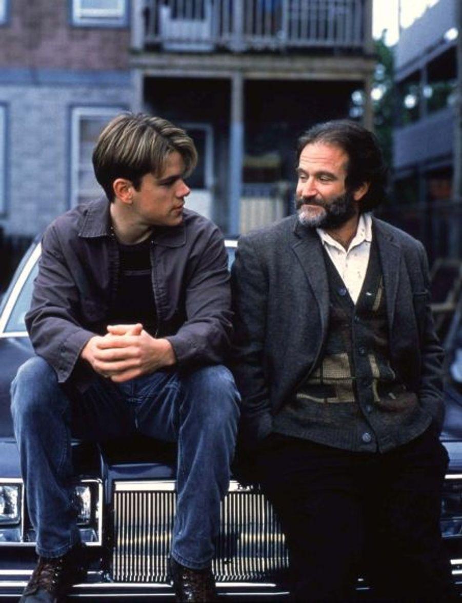 """Après une second rôle dans Mystic Pizza en 1988, Matt Damon obtient son premier grand rôle dans un film qu'il a lui-même écrit, avec son grand ami Ben Affleck, """"Will Hunting"""". Matt interprète le rôle titre, aux côtés de Robin Williams."""