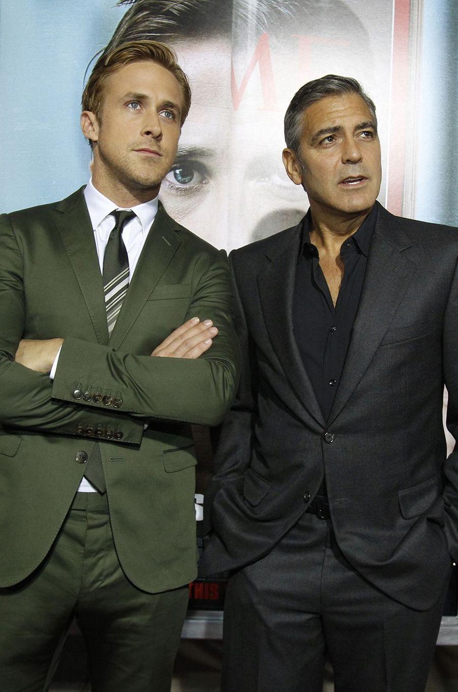 """Ryan avec son ami Georg Clooney à l'avant-première des """"Marches du pouvoir"""", 2011"""
