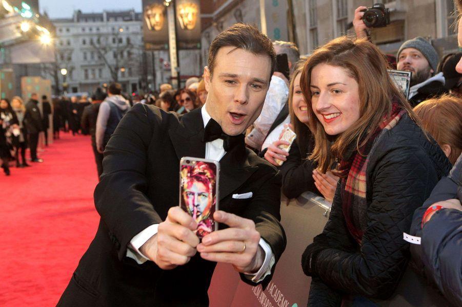 Rupert Evanssur le tapis rouge des BAFTA 2017, le dimanche 12 février 2017.