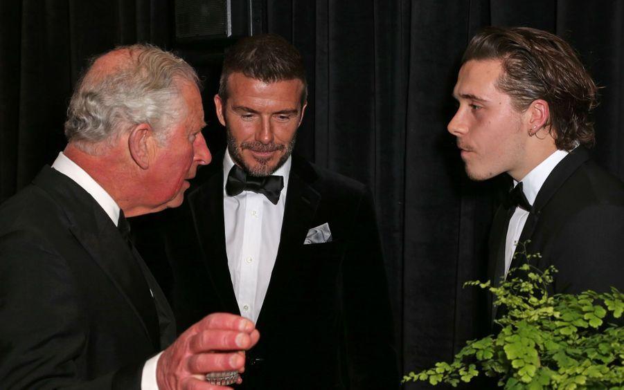 David Beckham, son fils Brooklyn et le prince Charles à Londres, le 4 avril 2019