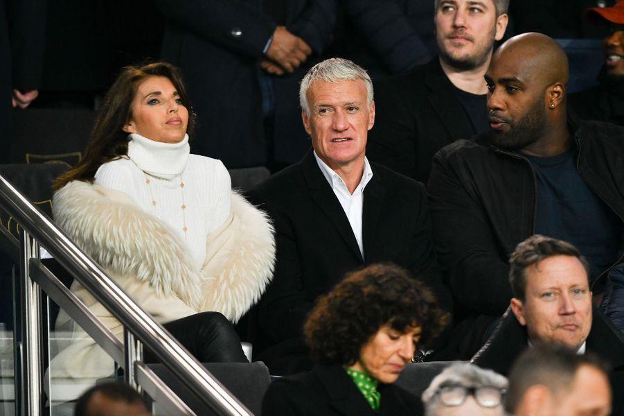 Didier Deschamps, sa femme Claude et Teddy Riner dans les tribunes du parc des Princes, le 6 mars 2019